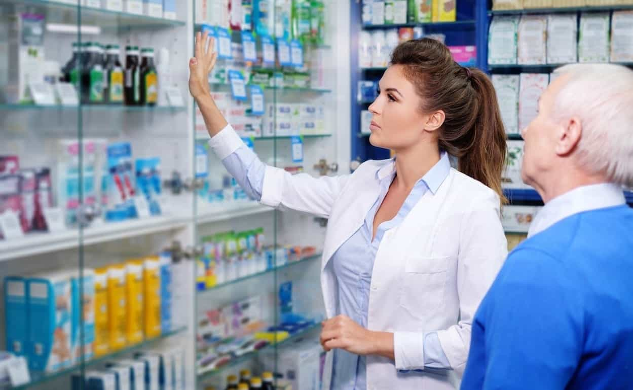 pharmacist showing drugs