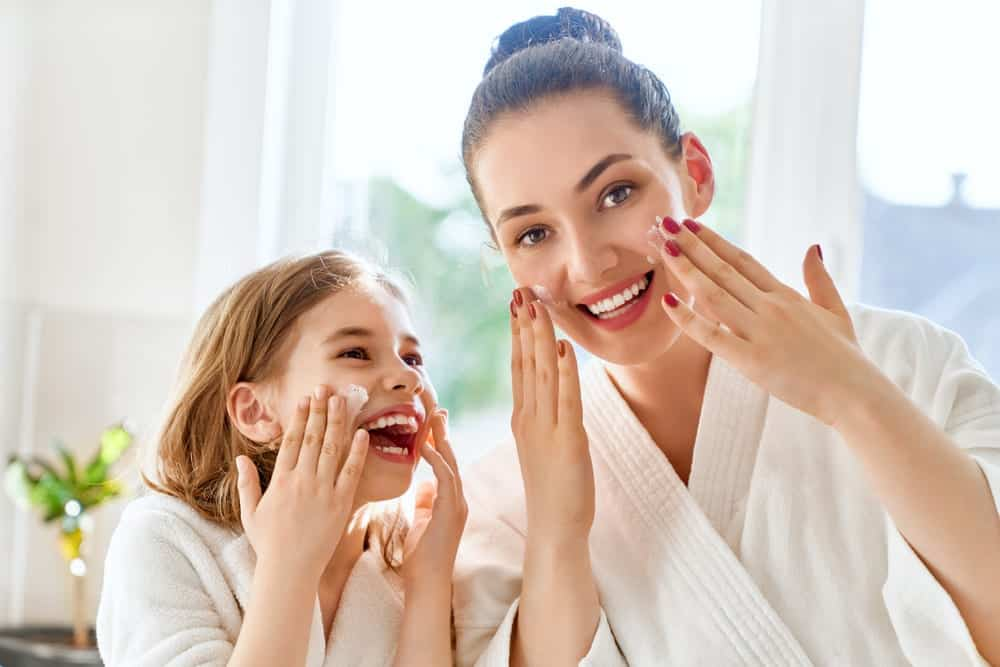 A mom and daughter taking care fo their skin
